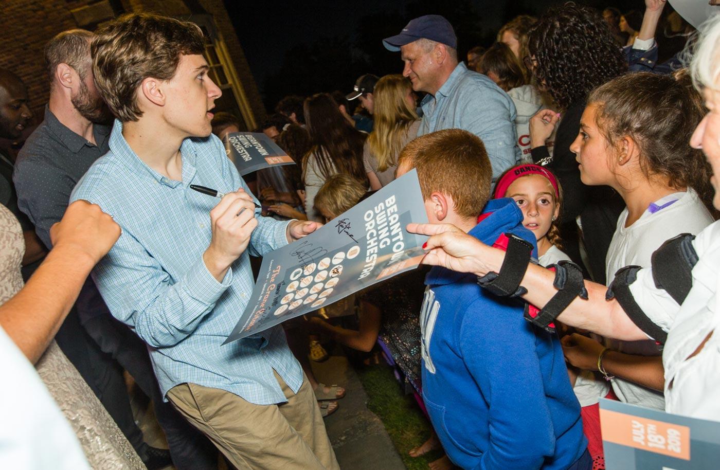 Matt signing autographs after a concert